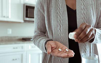 a woman taking medication