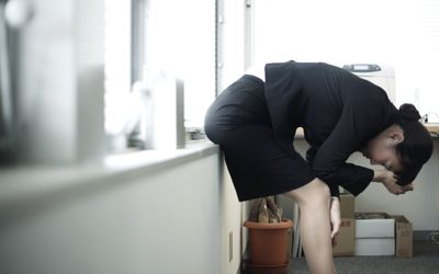 stressed businesswoman at office