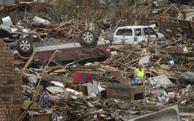 woman in aftermath of a tornado