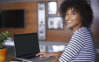 African American female student on laptop