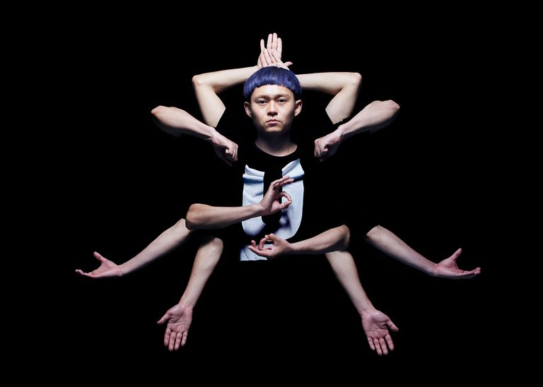 the hexagram pose - an asian person with 10 arms in a trick photograph