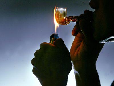 Man Smoking Meth