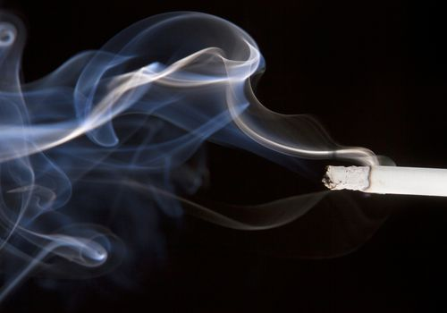 cigarette smoke on a black background