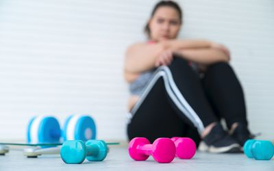 woman sitting on floor after working out