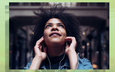 Woman looking up with earbuds on