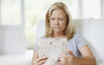Woman looking at framed picture