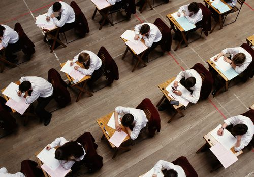 overhead view of students taking test