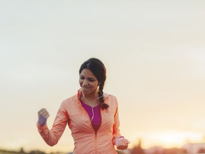 happy woman in athletic clothing