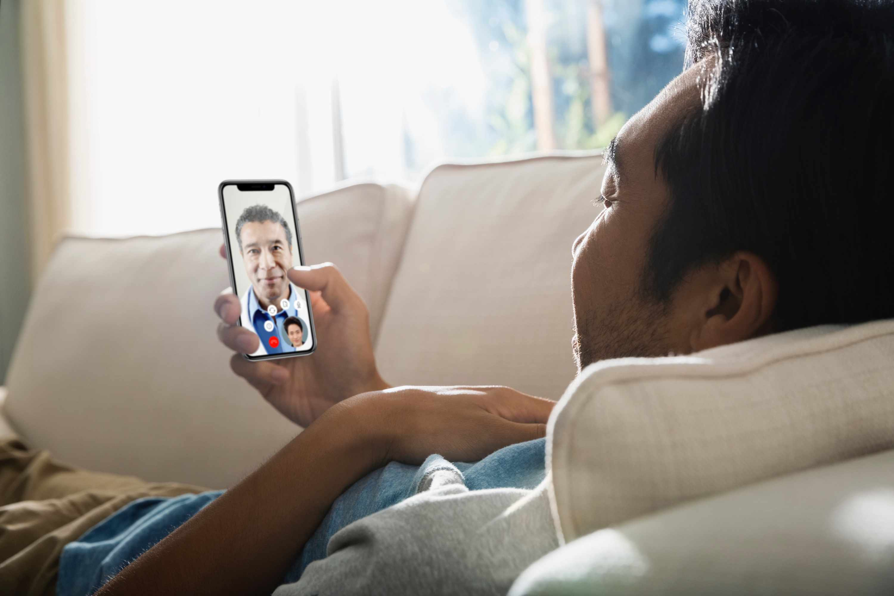 Person chatting with health provider on their phone via video chat