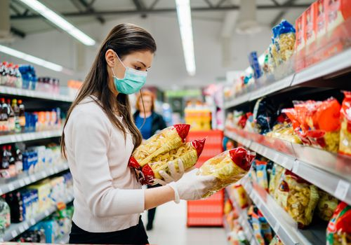 Woman shopping and wearing a mask.