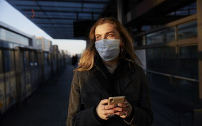 Woman alone wearing a face mask