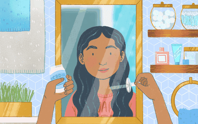 A person in their bathroom in front of the mirror about to use a dropper bottle labeled