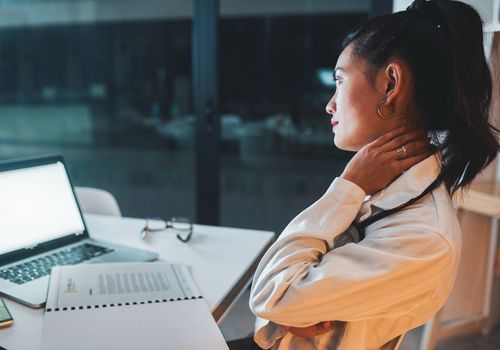 woman working looking stressed