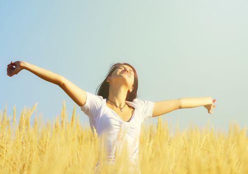 Woman breathing in field