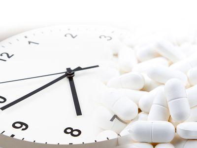 Clock with white pills