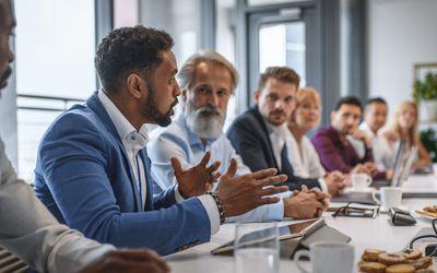 Black man speaking at a work meeting