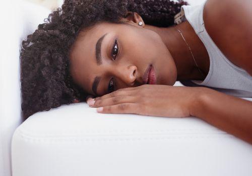 Portrait of black girl suffering solitude and depression