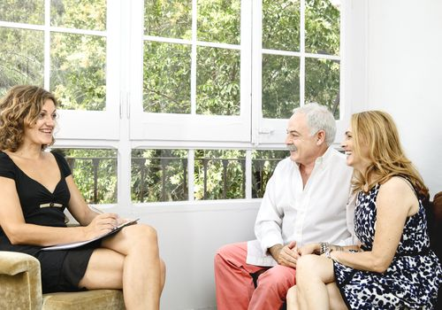 A clinical psychologist with clients