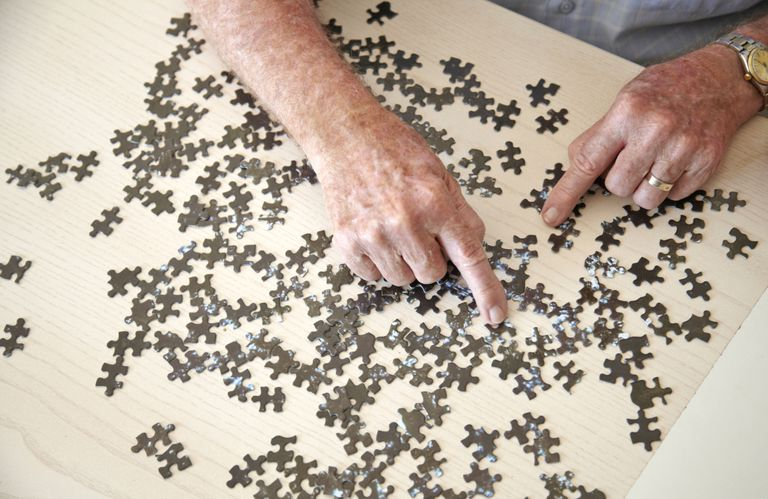 Man doing jigsaw puzzle.