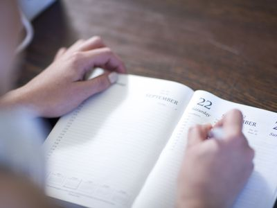 Woman writing in a day planner