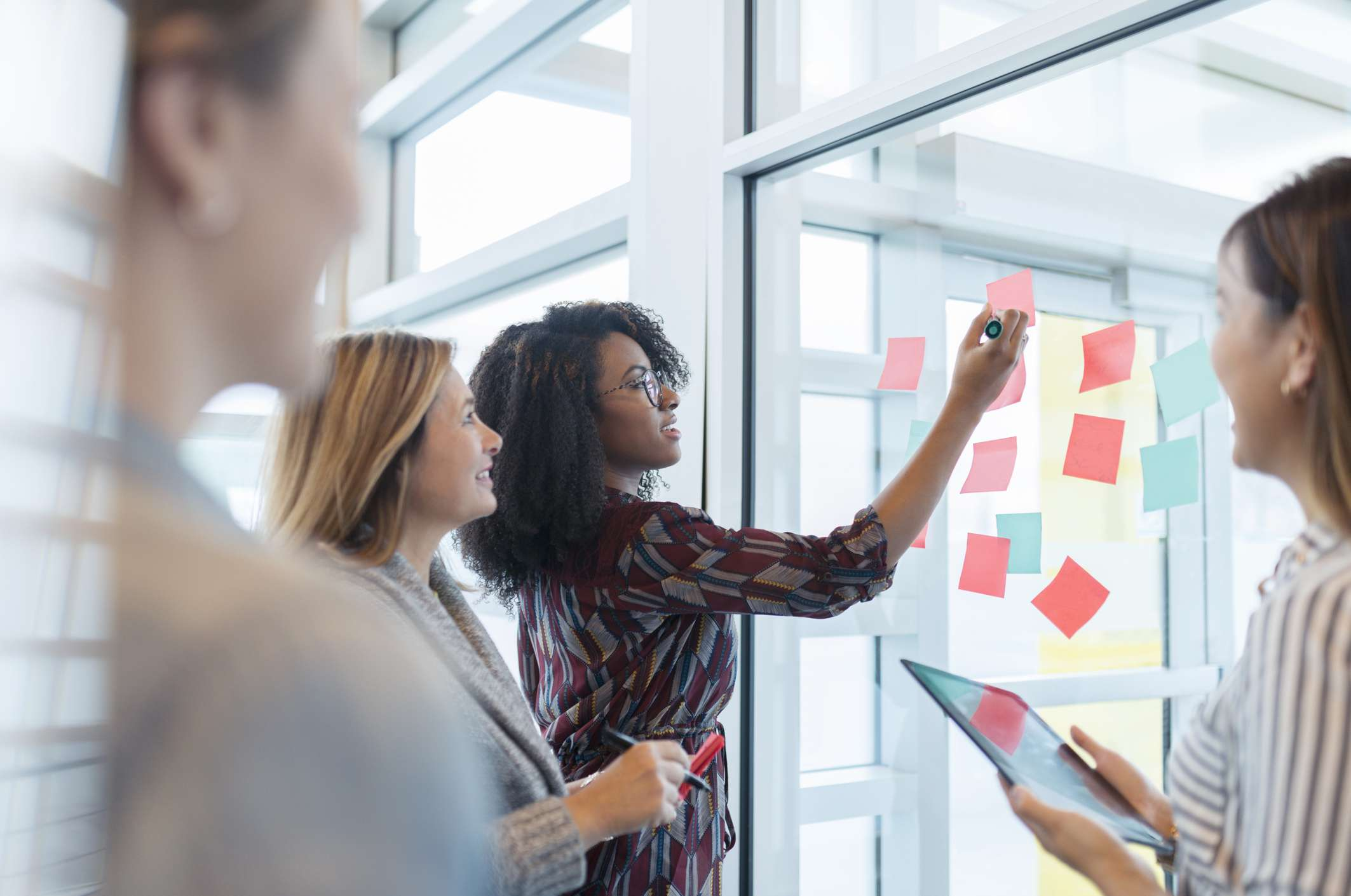 Woman making decisions in meeting