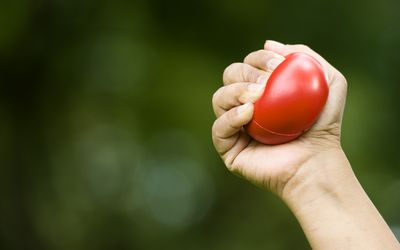 A hand squeezing a stress ball