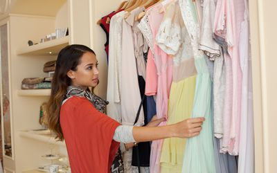 Young woman shopping at boutique.
