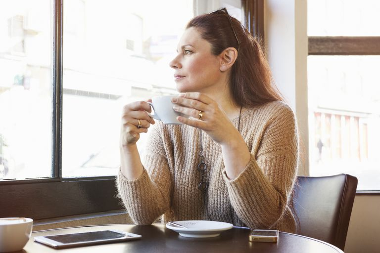 Thoughtful woman with a cup of coffee