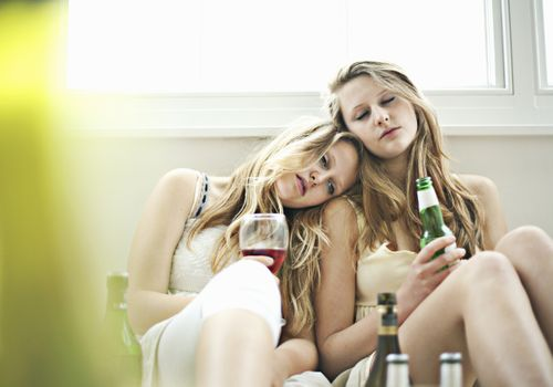 Drunken teenage girls dozing together