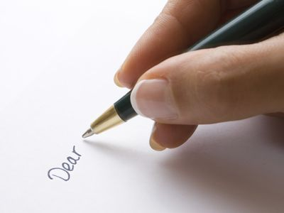 Woman beginning to write a letter