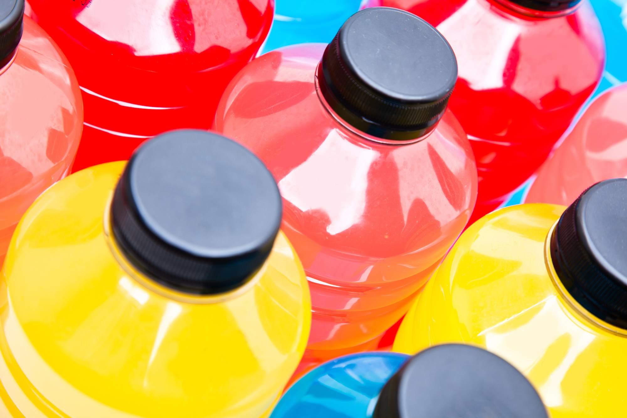 Multiple colorful bottles of sports drink