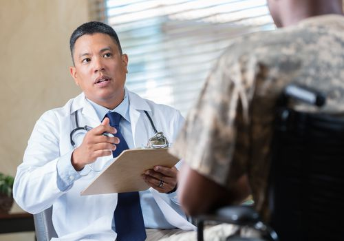 Medical doctor evaluates veteran during an appointment