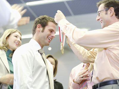 Man receiving an award in an office