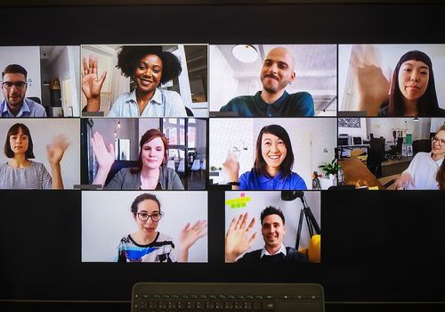 Group of multiracial and multigender individuals on a Zoom call