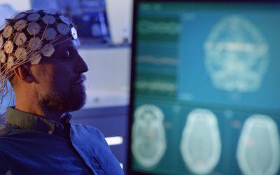 A man having an EEG to measure brain wave activity.