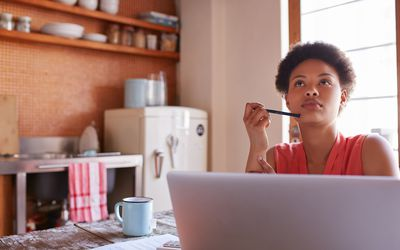 Woman thinking at kitchen table