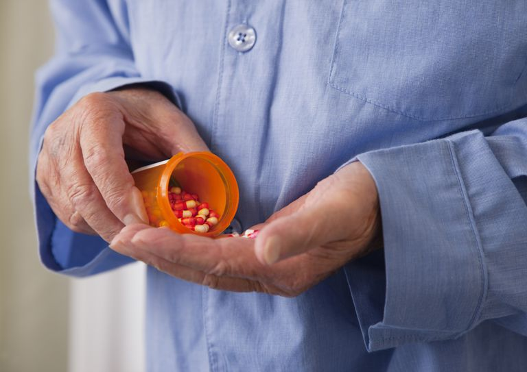 Man Getting Pill From Bottle
