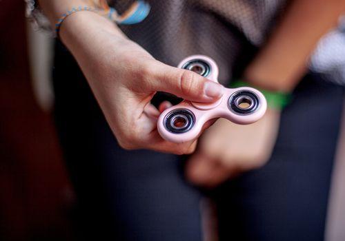 close-up on girl's hand holding fidget spinner