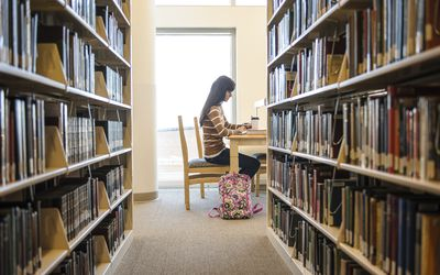 Woman working in the library