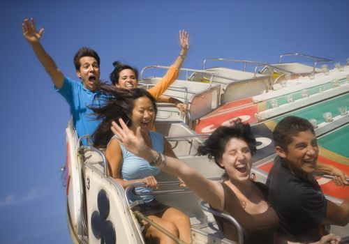 People riding amusement park ride