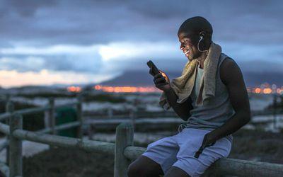 man smiling looking at his phone