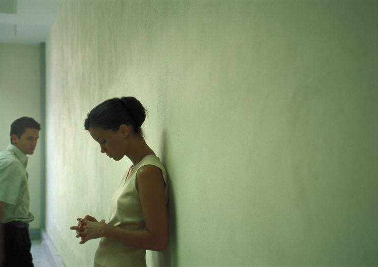 Sad woman and man in a hallway