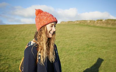 Profile of young woman smiling in countryside