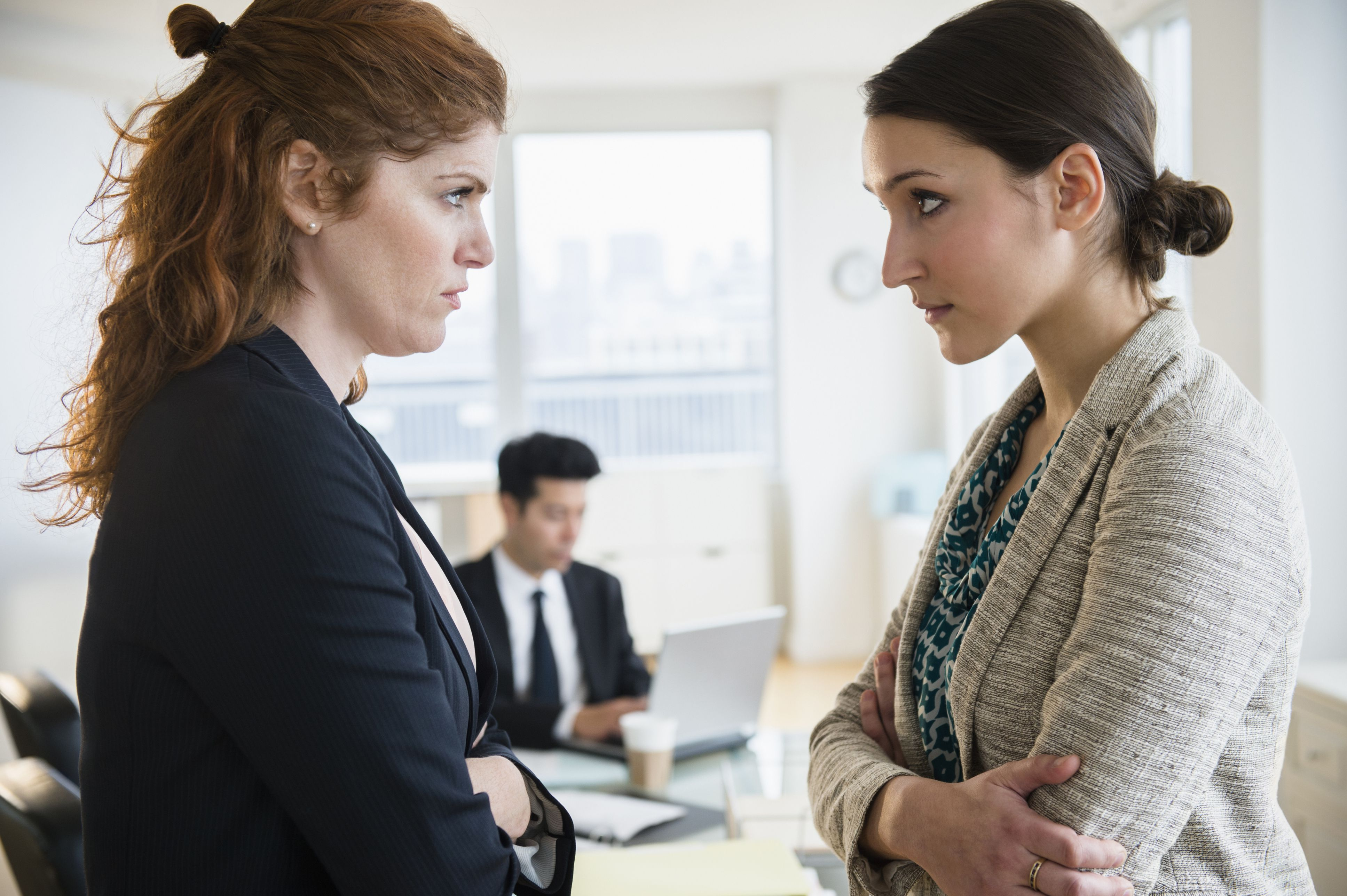Two women facing off in a meeting
