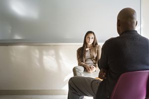 Young woman and psychologist talking