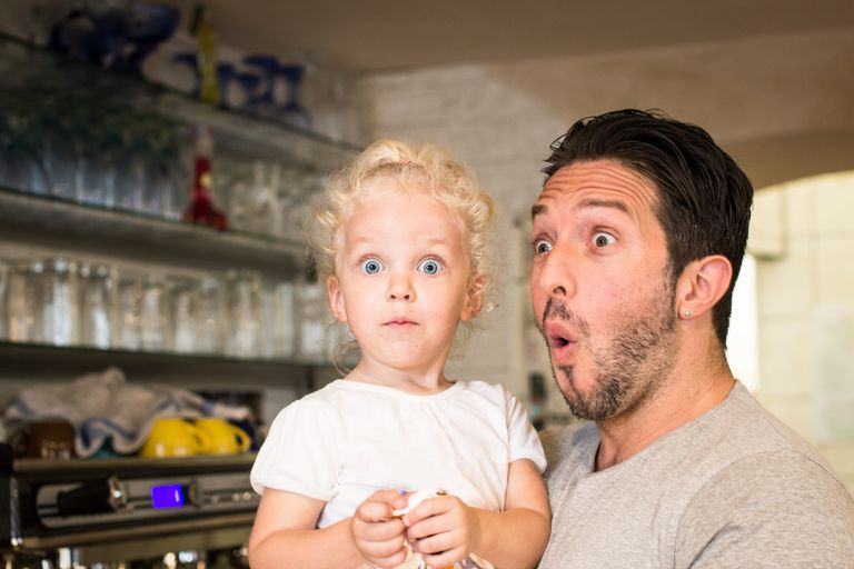 Funny portrait of father and daughter