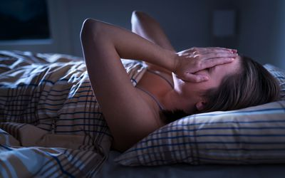 Woman with bipolar disorder waking up from a nightmare