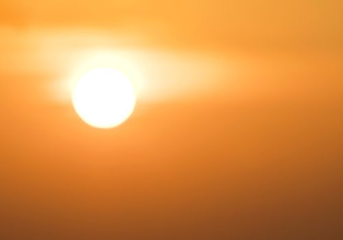image of a sun with an orange background