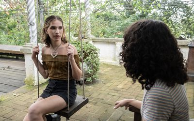 Transgender woman talking in the backyard
