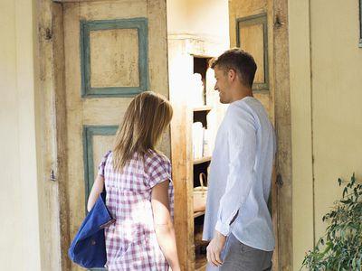 Man Holding Door for Woman